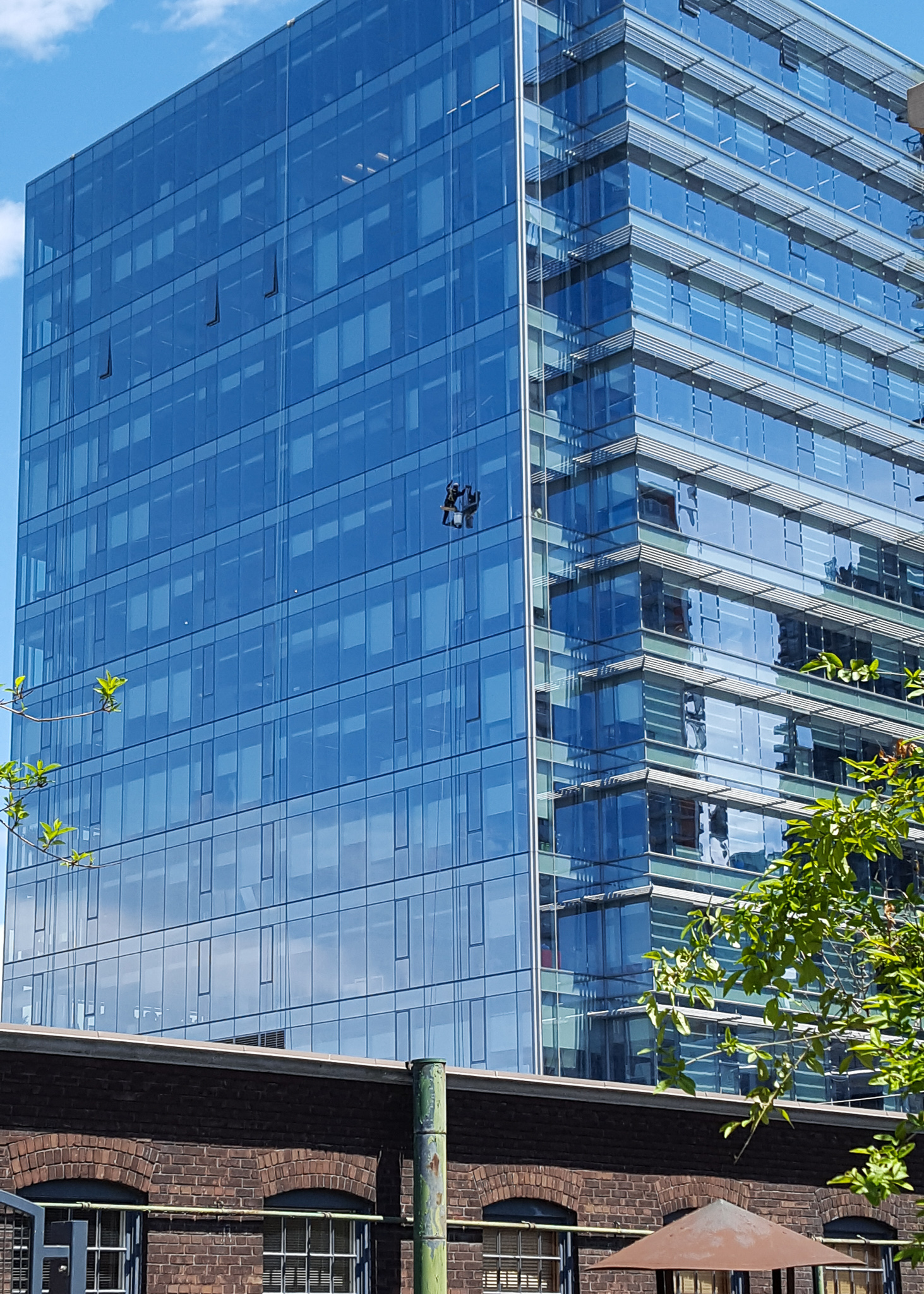 window cleaner scaling large building