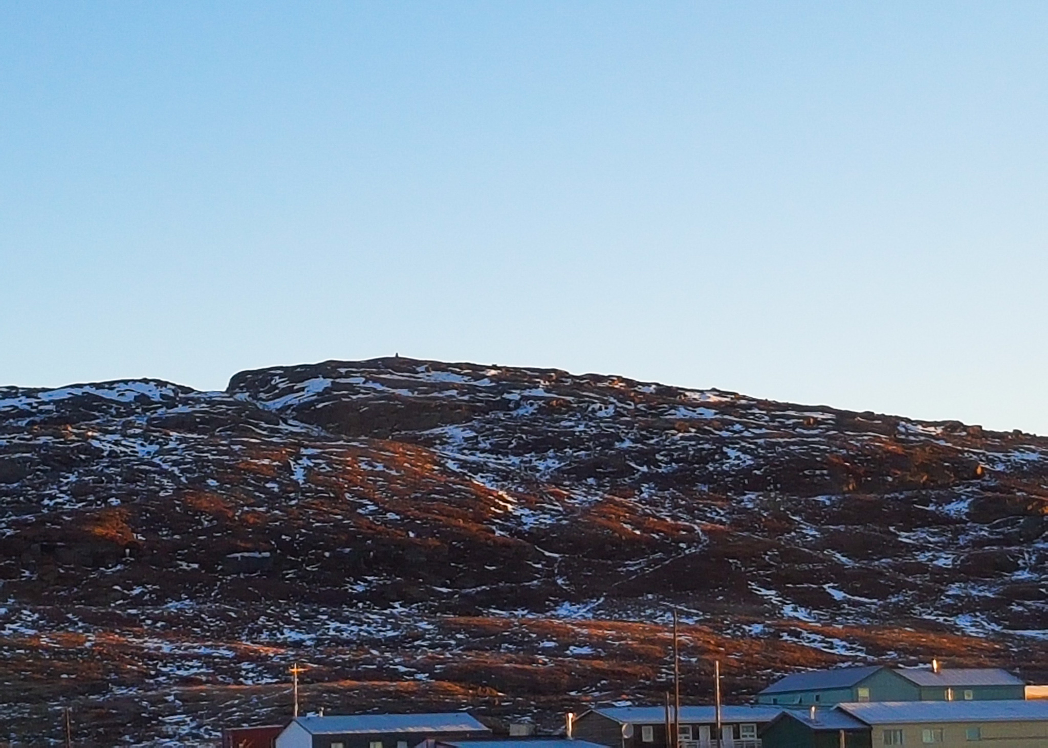 partially snowy hill