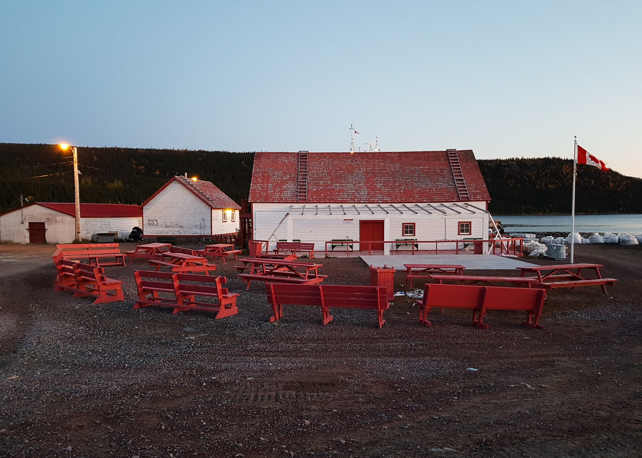 red roofed building and red benches