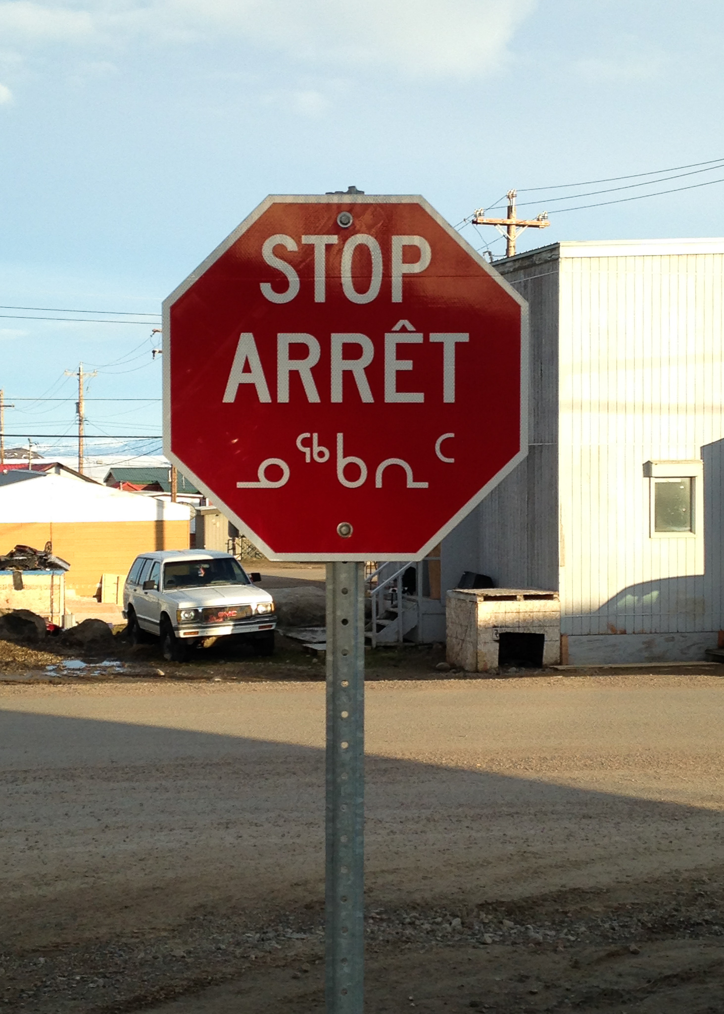 stop sign with car in background