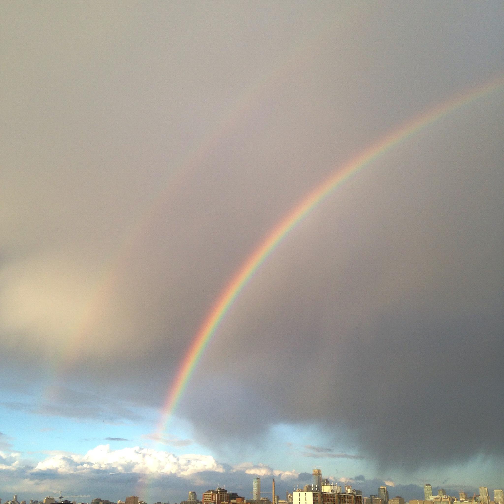 a rainbow over city